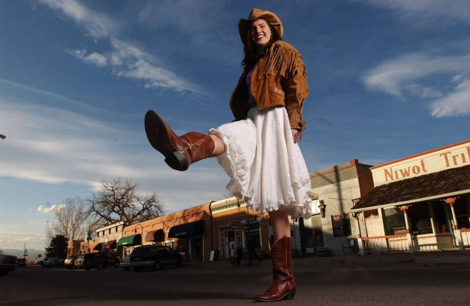 Model Kara Oliver shows off a mixture of modern and vintage clothes. Photo: Glenn Asakawa, Denver Post Via Getty Images