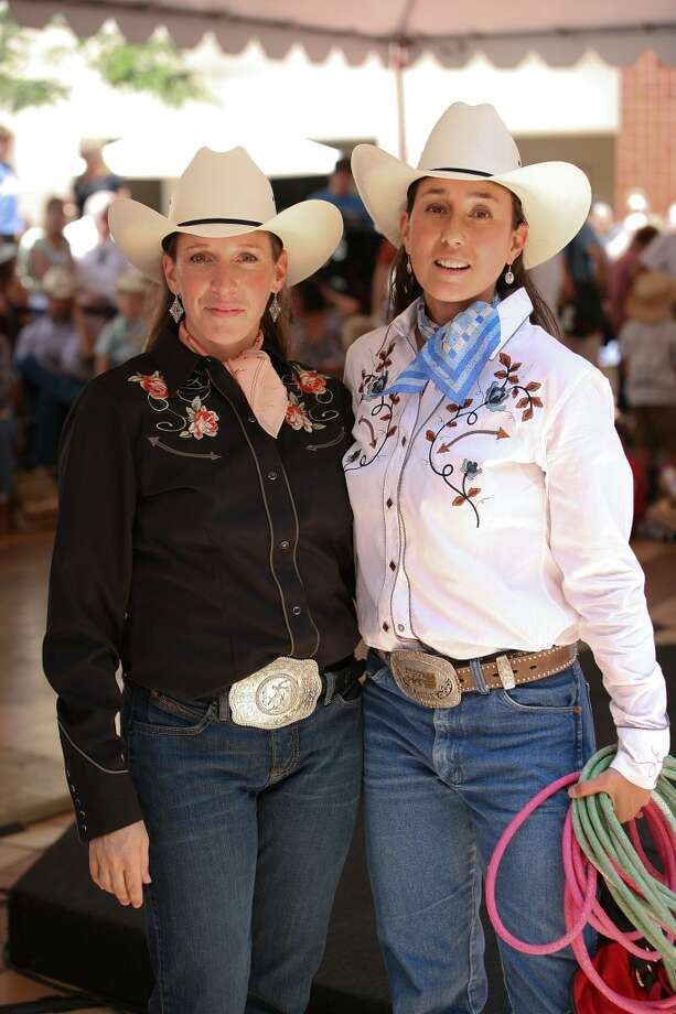 Lasso artists Landon Spencer (L) and Kansas Carradine (R) pose during the Day of the Cowboy and Cowgirl at the Autry National Center on July 23, 2011 in Los Angeles. Photo: Ryan Miller, Getty Images
