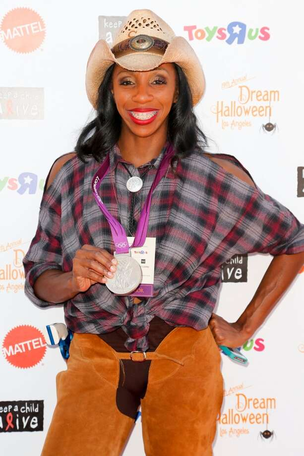Olympic athlete Lashinda Demus attends the 2012 'Dream Halloween' presented by Keep A Child Alive at Barker Hangar on October 27, 2012 in Santa Monica, California. Photo: Imeh Akpanudosen, Getty Images