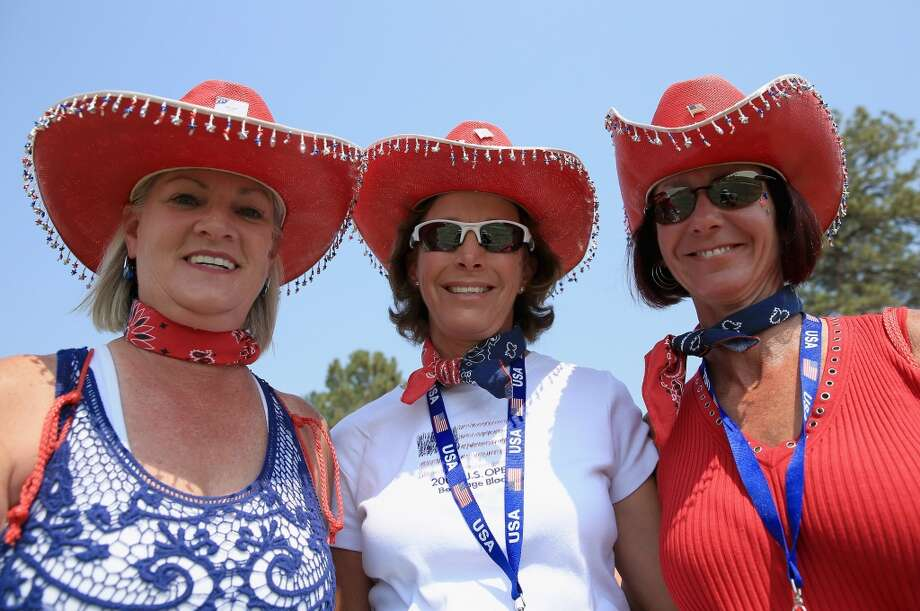Fans dress up to support the United States Team at the 2013 Solheim Cup on August 16, 2013 at the Colorado Golf Club in Parker, Colorado. Photo: Doug Pensinger, Getty Images