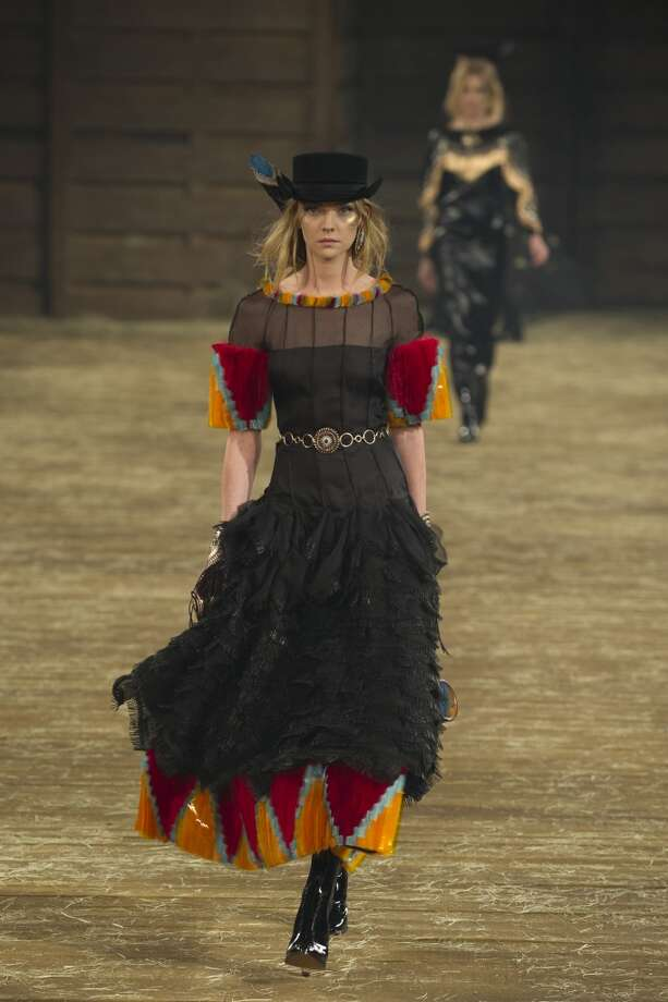 "A model walks the runway during the Chanel ""Metiers d'Art"" Show at Fair Park on December 10, 2013 in Dallas. Photo: Cooper Neill"