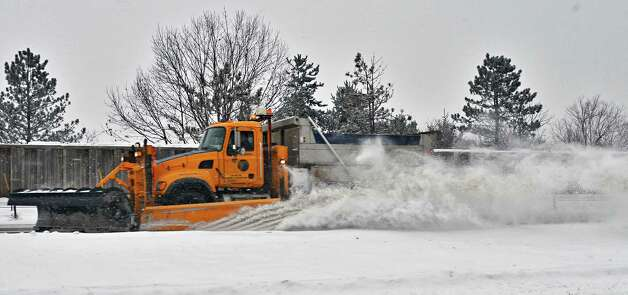 A NYS DOT snowplow works to clear snow in the westbound lanes of Alternate Route 7, Tuesday Dec. 17, 2013, in Colonie, NY.  (John Carl D'Annibale / Times Union) Photo: John Carl D'Annibale / 00025077A