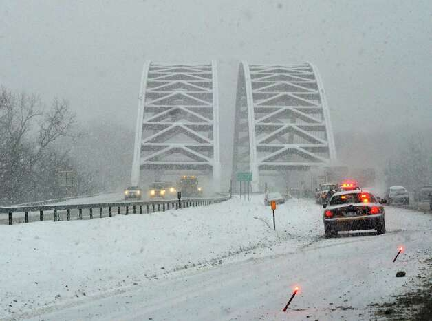 A south bound lane of Interstate 87 is blocked off by State Police just north of the Twin Bridges for a vehicle that slid off the road on Tuesday, Dec. 17, 2013 in Clifton Park, NY.   (Paul Buckowski / Times Union) Photo: PAUL BUCKOWSKI / 00025077A