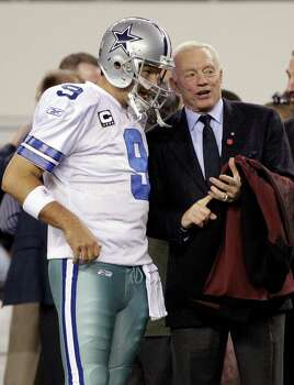 ADVANCE FOR WEEKEND EDITIONS, MAY 4-5 - FILE - In this Dec. 11, 2011 file photo, Dallas Cowboys quarterback Tony Romo (9) and team owner Jerry Jones, right, talk before an NFL football game against the New York Giants, in Arlington, Texas. Jones first alluded to an expanded role for Romo the day the Cowboys owner and general manager signed his quarterback to a $108 million extension with more guaranteed money than Super Bowl winner Joe Flacco. (AP Photo/Tony Gutierrez, File) Photo: Associated Press / AP