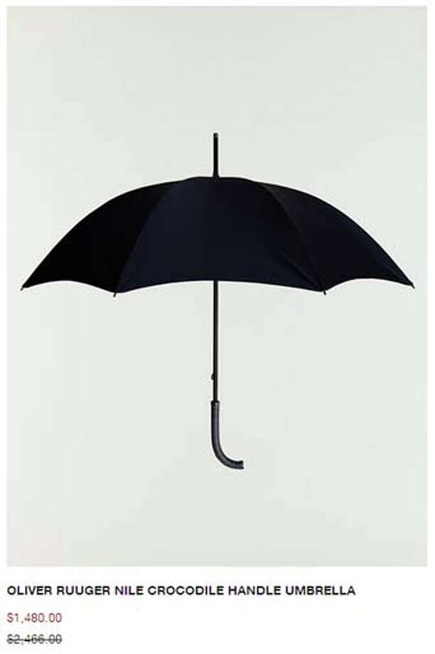 If your bank account is making it rain, stand under this crocodile handle 