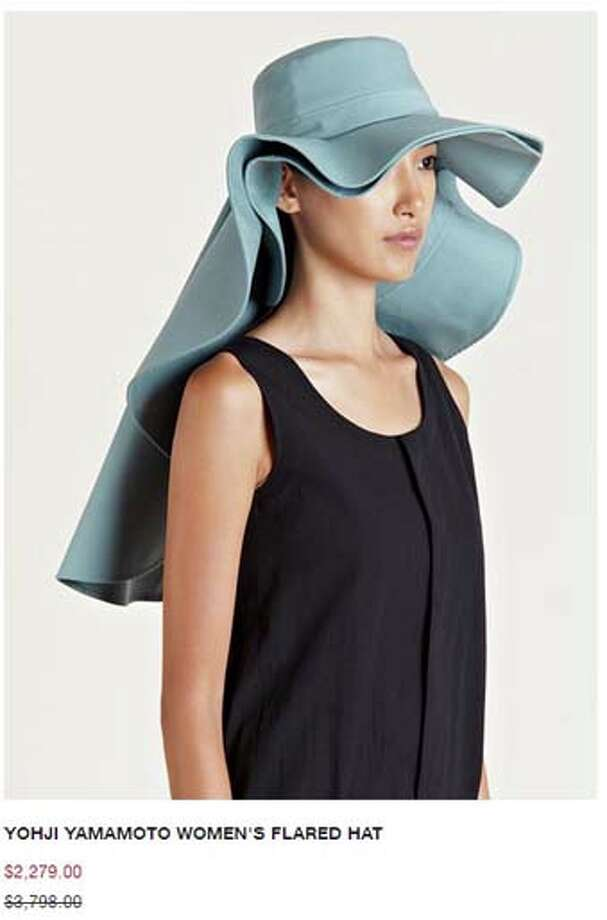 Are you rich and in need of a really ugly hat? Look no further! For a measly $2K , you too can hide your face in shame under this hat's layers of ruffles.
