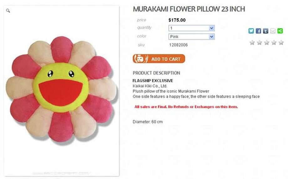 Want to snuggle up to something after a long day of shopping? Reach for this disturbing smiley face flower pillow, priced at a relatively reasonable $175.