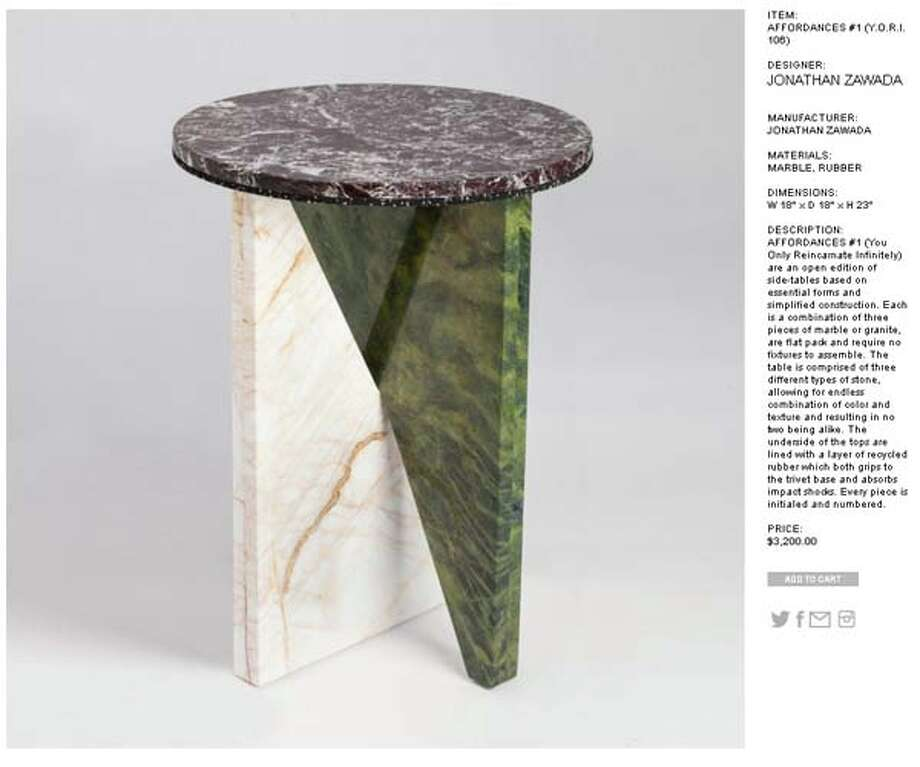 This marble and rubber table will set you back over $3K. And it doesn't even include chairs.