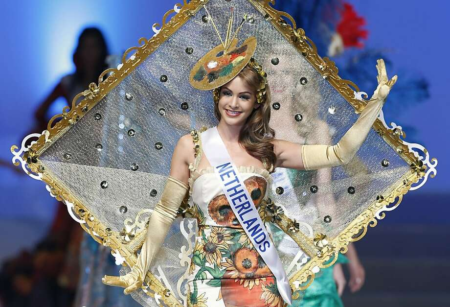 Self-portrait: Miss Netherlands Nathalie den Dekker presents her national costume - which appears to be gold leaf-framed mosquito netting with an artist's palette for a hat - during the final of the 53rd Miss International Beauty Pageant in Tokyo. She was named first runner-up. Photo: Shizuo Kambayashi, Associated Press