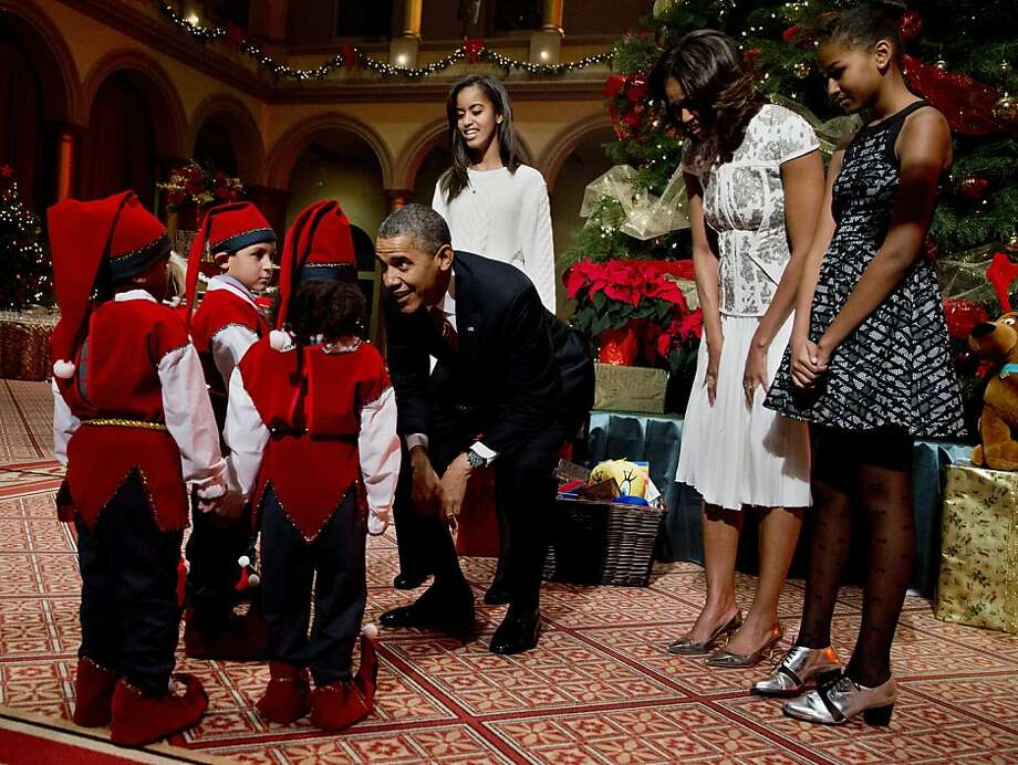 We're here to fix healthcare.gov: Elves visit with the first family at the National Building Museum in Washington, where the president, first lady, Malia and Sasha were taping the annual Christmas special. Photo: Manuel Balce Ceneta, Associated Press