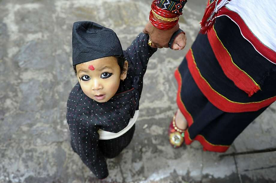 Too much eye liner?  An ethnic Newar child wears traditional clothing during a parade marking Jyapu Day, the end of the harvest season, in Kathmandu. Photo: Prakash Mathema, AFP/Getty Images