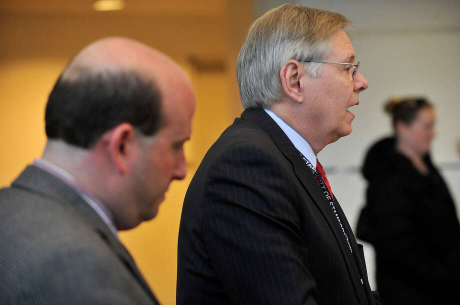 Mayor David Martin, right, speaks at a press conference at the Stamford Government Center in Stamford, Conn., on Tuesday, Dec. 17, 2013. The mayor announced that the city of Stamford is in discussions with the Sisters of St. Joseph of Chambery for the purchase of buildings that hold The Stanwich School's Stamford Campus in order to help in alleviating elementary school overcrowding in the city. President of the Board of Education Geoffrey Alswanger stands to the left. Photo: Jason Rearick / Stamford Advocate
