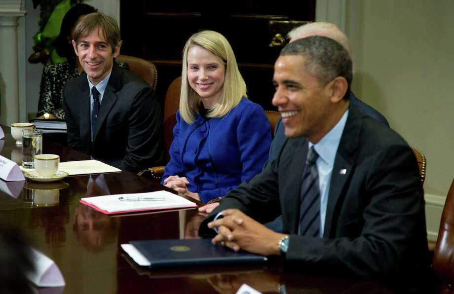 President Barack Obama meets with technology executives in the Roosevelt Room of the White House in Washington, Tuesday, Dec. 17, 2013. From left are, Mark Pincus, founder, Chief Product Officer & Chairman, Zynga; Marissa Mayer, President and CEO, Yahoo!, and Obama. (AP Photo/ Evan Vucci) Photo: Evan Vucci, STF / AP