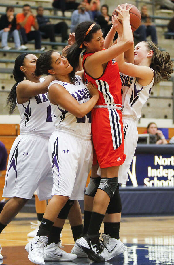 Brandeis' Morgan Williams, second from right, fights for a rebound with Warren's Adrienne Lightfoot, left, Lauryn Elliot and Victoria Hall during the first half of their Dec. 4 game. Photo: Marvin Pfeiffer / Northwest Weekly / Prime Time Newspapers 2013