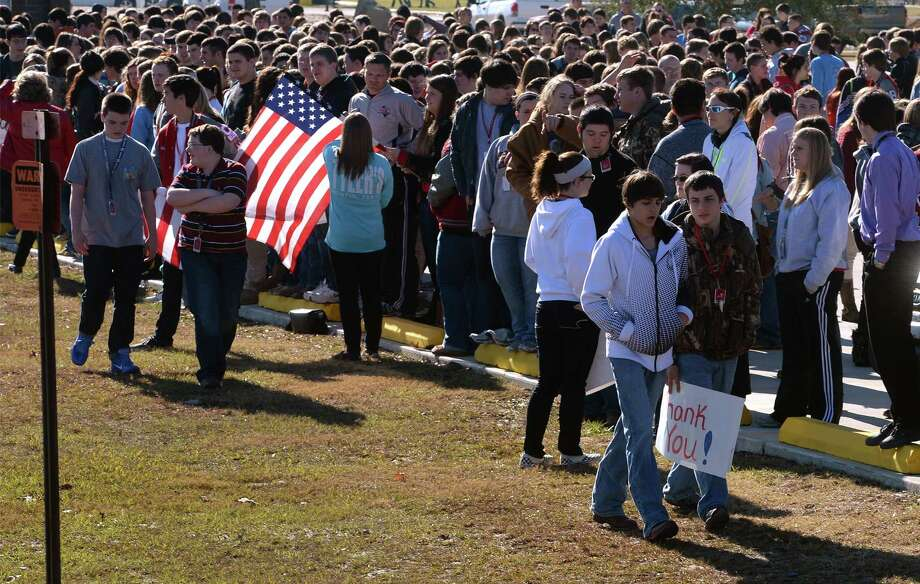 Lumberton High School students wait for the funeral procession of Cpl. William Aaron Newton on Tuesday. A POW from the Korean War, Newton's remains were recently identified and returned to his family.  Photo taken Tuesday, December 17, 2013 Guiseppe Barranco/@spotnewsshooter Photo: Guiseppe Barranco, Photo Editor