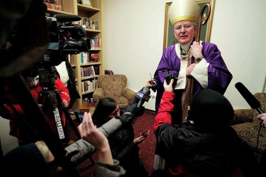 File - In this Dec. 15, 2013 file photo Archbishop John Nienstedt, head of the Archdiocese of St. Paul and Minneapolis, talks to the media at Our Lady of Grace Church in Edina, Minn. Nienstedt, in a letter posted Tuesday, Dec. 17, 2013 on the archdiocese website, says he is stepping aside from public ministry after an allegation that he touched an underage male. Nienstedt denies the allegations, but is removing himself from ministry pending an investigation. (AP Photo/The Star Tribune, Richard Tsong-Taatarii, File)  MANDATORY CREDIT; ST. PAUL PIONEER PRESS OUT; MAGS OUT; TWIN CITIES TV OUT Photo: Richard Tsong-Taatarii, MBO / The Star Tribune