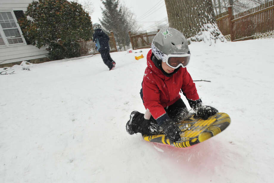 Ayden Mehl goes off an improvised ramp in his back yard in Stamford, Conn., on Tuesday, Dec. 17, 2013. Photo: Jason Rearick / Stamford Advocate