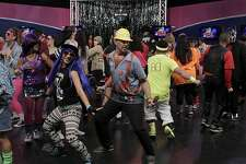 Ron Knapp (center) dances as a plumber for the taping for an episode of the Dance Party show at KOFY-TV studios in San Francisco, Calif. on Saturday, Dec. 14, 2013.