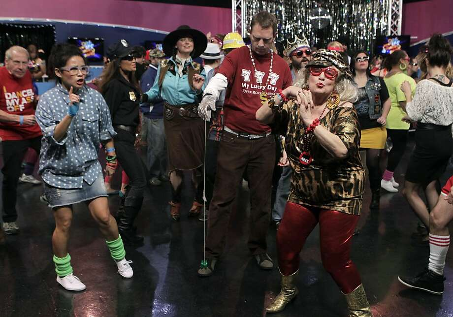 "Walter Paulson, known as ""The Yo-Yo Man"" and Karen Alexander (right) dance at a taping for an episode of the Dance Party show at KOFY-TV studios in San Francisco, Calif. on Saturday, Dec. 14, 2013. Photo: Paul Chinn, The Chronicle"