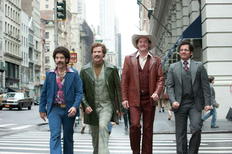 "Paul Rudd, from left, Will Ferrell, David Koechner and Steve Carell star in ""Anchorman 2: The Legend Continues."" Photo: Gemma LaMana, HOEP / Paramount Pictures"