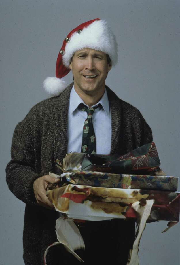National Lampoon's Christmas Vacation - Chevy Chase as Clark Griswold / handout slide
