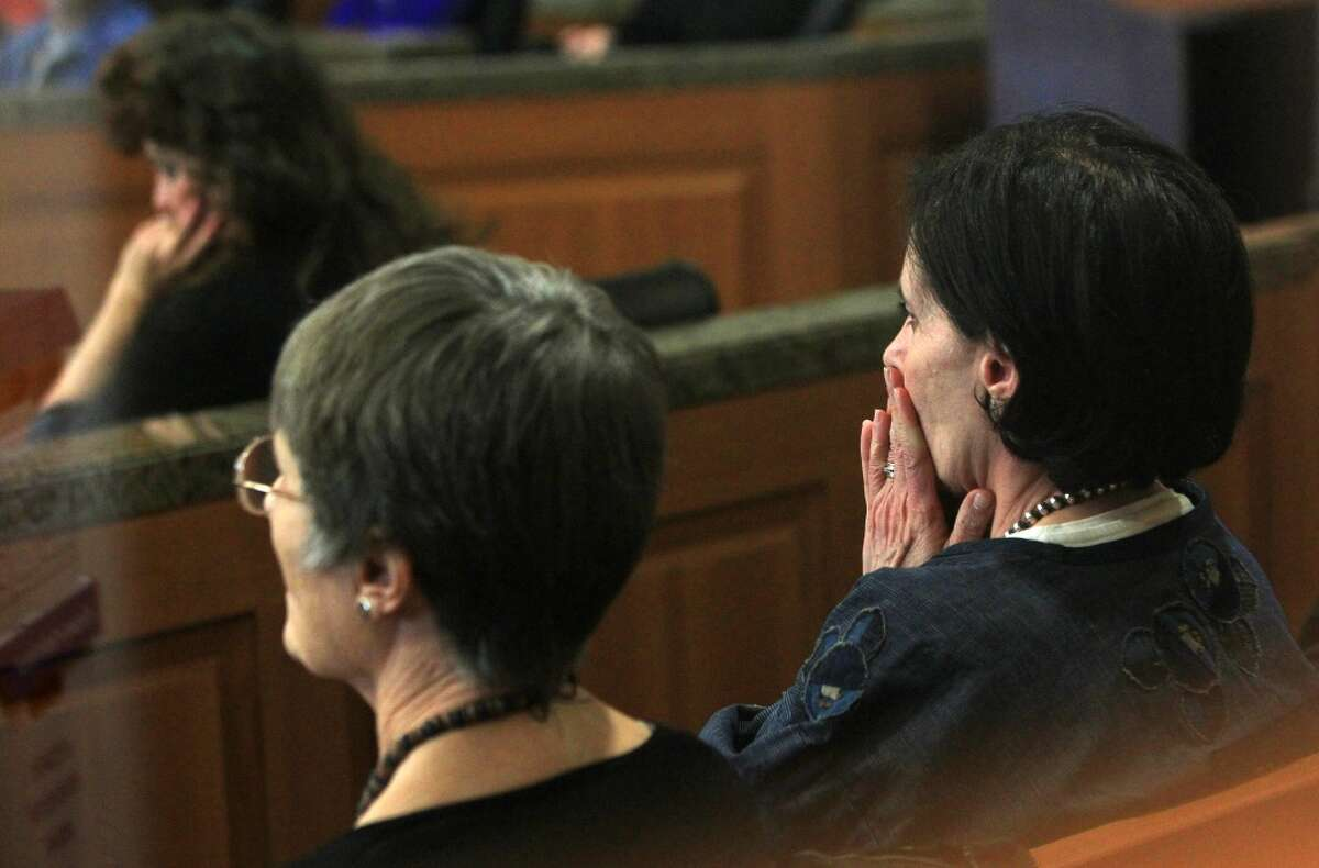 Leslie Miller listens to Judge Randy Wilson read the verdict in the Ashby Highrise Trial at the Harris County Civil Courthouse on Tuesday, Dec. 17, 2013, in Houston. The jury determined project would interfere with residents property rights, and awarded some of the plaintiffs not all. ( Mayra Beltran / Houston Chronicle )