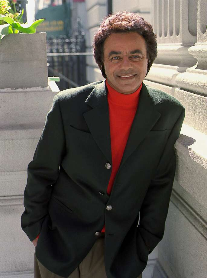 FOR IMMEDIATE RELEASE--Singer Johnny Mathis poses on a New York street, April 25, 2000. Mathis, 64, has a new CD, ``Mathis on Broadway,'' which includes ``Children Will Listen'' and ``Our Children,'' from the musicals ``Into the Woods'' and ``Ragtime,'' which are combined on the CD as a duet with Betty Buckley. (AP Photo/Jim Cooper).     HOUCHRON CAPTION (09/28/2001):  Mathis.     HOUCHRON CAPTION (02/03/2002):  Singer Johnny Mathis will perform with the Houston Symphony at 8 p.m. Thursday.   Calendar EVENTS.   HOUCHRON CAPTION (09/30/2002):  Mathis. Photo: JIM COOPER, STR / AP