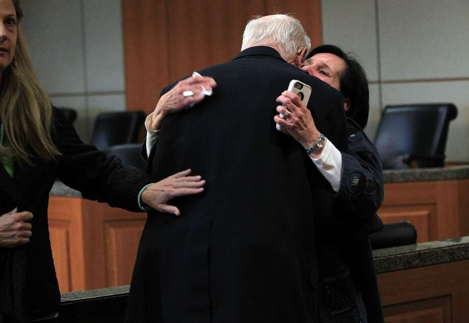 Plaintiff Earle Martin embraces plaintiff Leslie Miller after  Judge Randy Wilson read the verdict in the Ashby Highrise Trial at the Harris County Civil Courthouse on Tuesday, Dec. 17, 2013, in Houston. The jury determined project would interfere with residents property rights, and awarded some of the plaintiffs not all. ( Mayra Beltran / Houston Chronicle ) Photo: Mayra Beltran, Houston Chronicle