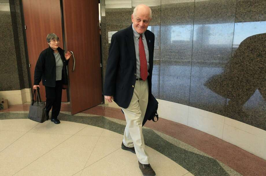 Plaintiffs Kristy Martin and Earle Martin walk out of courtroom after Judge Randy Wilson read the verdict for the Ashby Highrise Trial at the Harris County Civil Courthouse on Tuesday, Dec. 17, 2013, in Houston. The jury determined project would interfere with residents property rights, and awarded some of the plaintiffs not all. ( Mayra Beltran / Houston Chronicle ) Photo: Mayra Beltran, Houston Chronicle