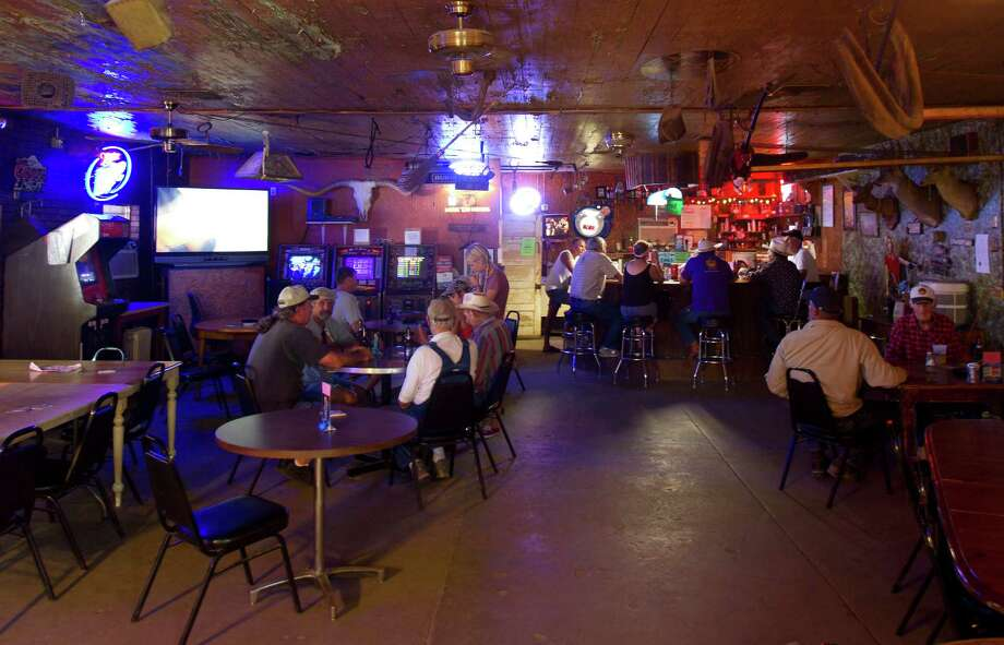 """Huebel's, a popular neon-lit watering hole in Smithville, was used in the movies """"Hope Floats"""" and """"Doonby."""" Photo: Cody Duty, Staff / © 2011 Houston Chronicle"""