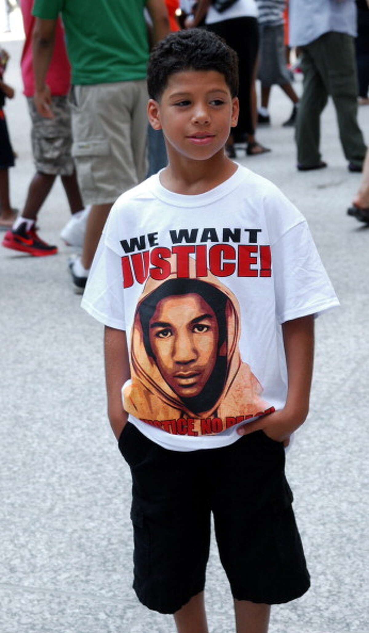 Trayvon Martin (pictured on shirt) ranks in at number 9 US trending people.