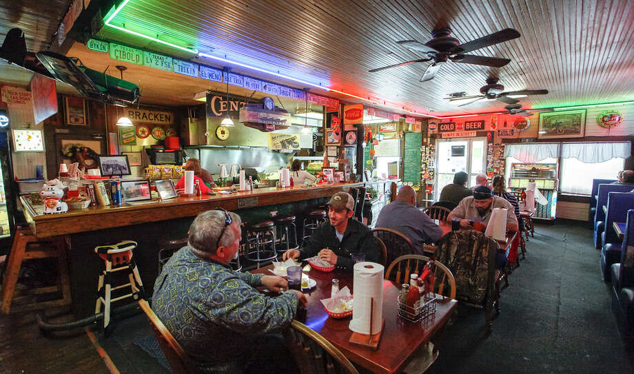 The Bracken Store Cafe's main dining room is awash in the hues of neon red, green and blue on a busy mid-December afternoon. Photo: Marvin Pfeiffer / NE Herald / Prime Time Newspapers 2013