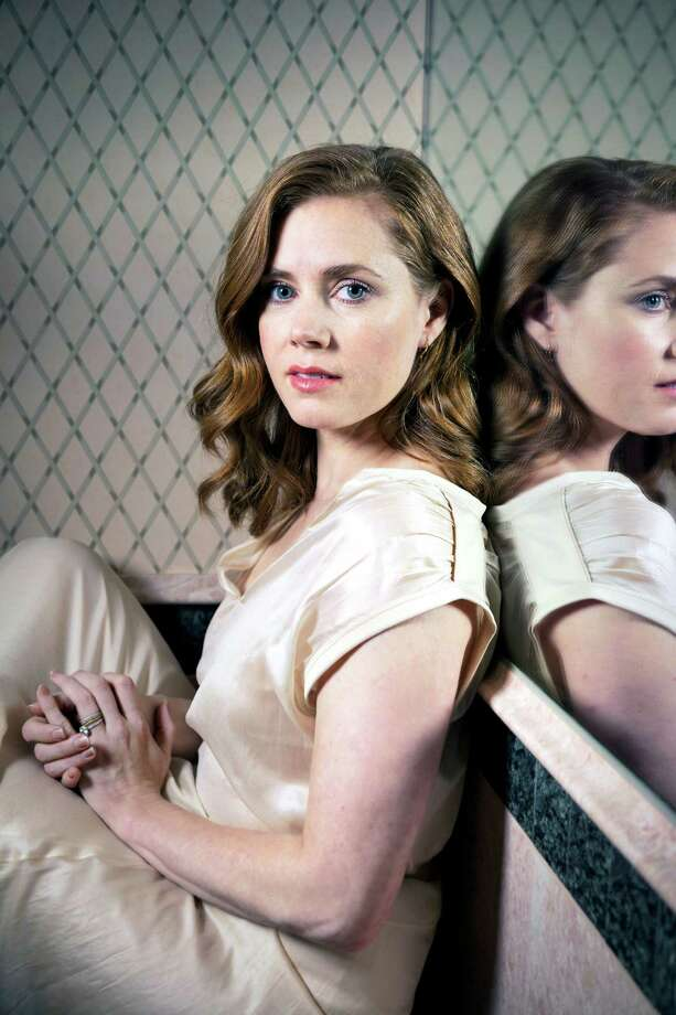 """Amy Adams says she's used to playing """"happy people,"""" but in """"American Hustle"""" she takes on her harshest role yet. Photo: Michael Lewis, STR / NYTNS"""