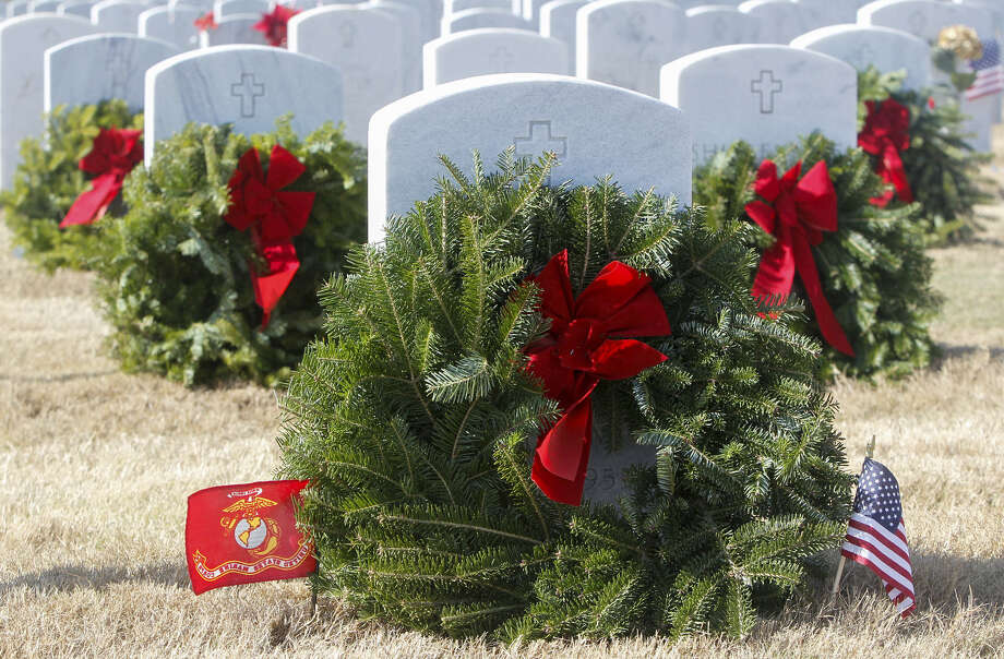 Wreaths were placed on headstones at Fort Sam Houston National Cemetery during Saturday's Wreaths Across America. Photo: Marvin Pfeiffer / NE Herald / Prime Time Newspapers 2013