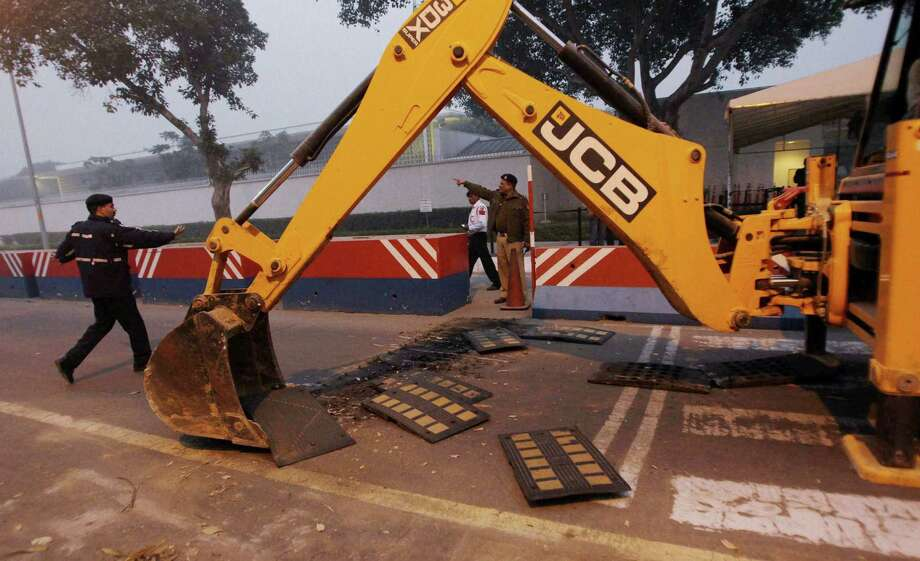 Indian police in New Delhi remove barricades outside the U.S. Embassy on Tuesday. Photo: STR / AP