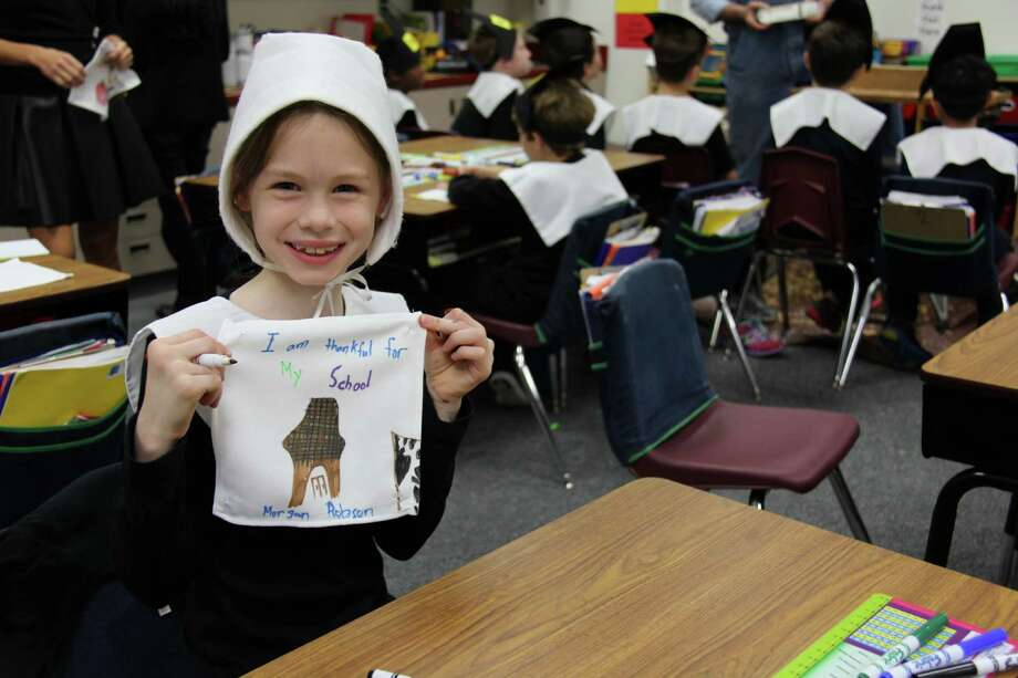 Second-grader Morgan Robson shows a quilt square she made during a day of Pilgrim life at The John Cooper School. Photo: Provided By The John Cooper School