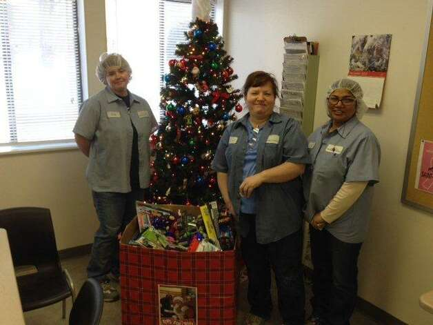 Saint-Gobain Performance PIastics in Poestenkill ran a toys-for-tots drive for about 40 people. Assisting are, from left, Kelly McCart, Laura Nadler and Lipi Chourdhury.