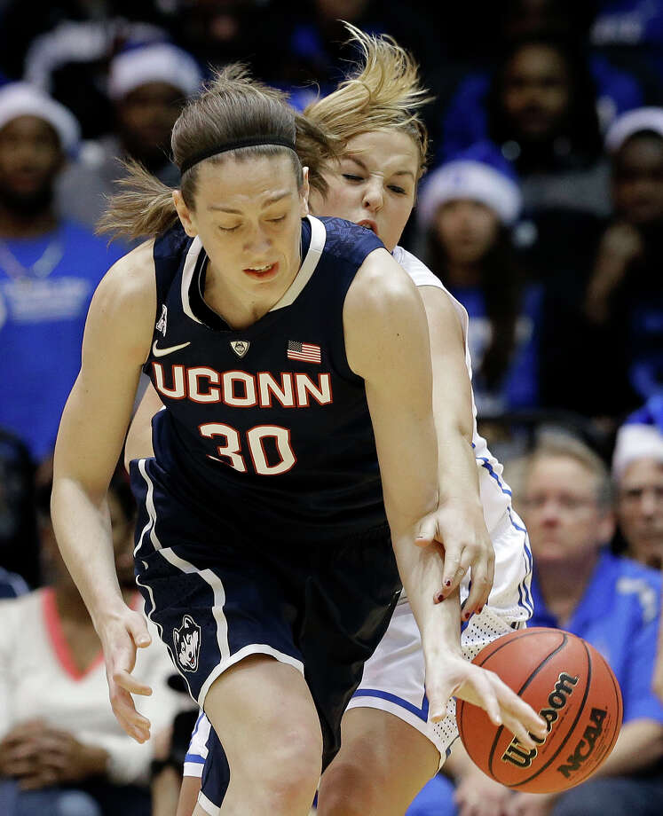 Connecticut's Breanna Stewart, left,  and Duke's Tricia Liston, right, reach for the ball during the first half of an NCAA college basketball game in Durham, N.C., Tuesday, Dec. 17, 2013. (AP Photo/Gerry Broome) Photo: Gerry Broome, Associated Press / Associated Press
