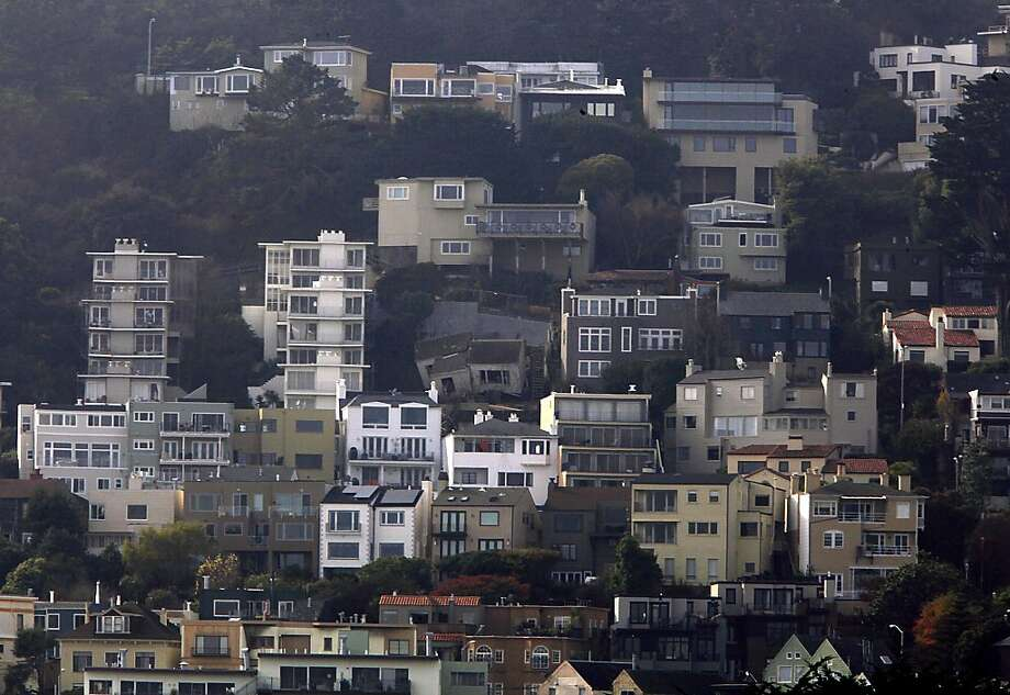 A Twin Peaks home under renovation at 125 Crown Terrace (middle), partially collapsed last night and slid down the hill to Graystone Terrace in San Francisco, Calif., as seen on Tuesday, December 17, 2013.  The home is owned by former building inspection commission president Mel Murphy. Photo: Liz Hafalia, The Chronicle