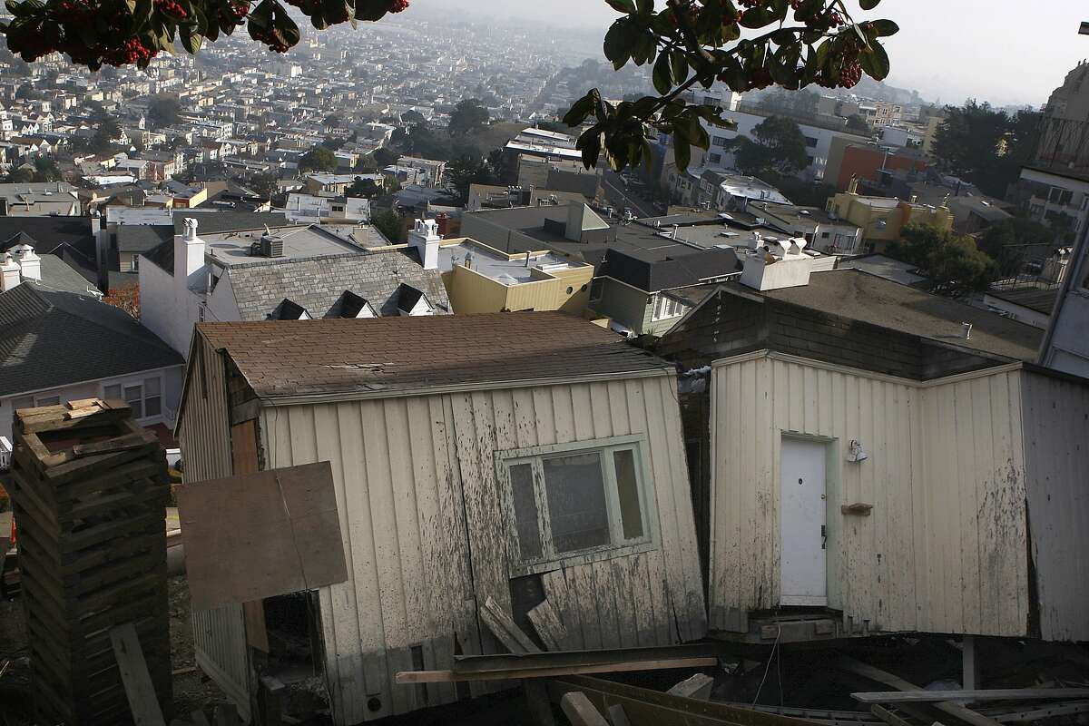A Twin Peaks home under renovation at 125 Crown Terrace, partially collapsed last night and slid down the hill to Graystone Terrace in San Francisco, Calif., as seen on Tuesday, December 17, 2013. The home is owned by former building inspection commission president Mel Murphy.