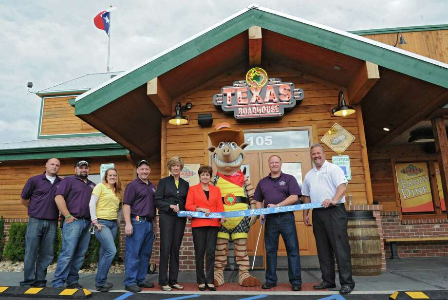Texas Roadhouse. 105 Wolf Rd., Colonie.Employees and town officials cut a ribbon at Texas Roadhouse restaurant which had their grand opening on Monday, Sept. 16, 2013 in Colonie, N.Y. (Lori Van Buren / Times Union) Photo: Lori Van Buren / 00023884A