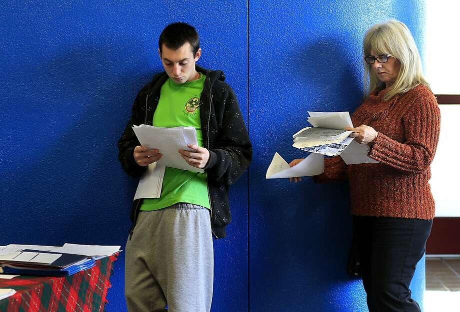 Eric Knowles and Carol Antraccoli look over letters to Santa. Photo: Brant Ward, The Chronicle
