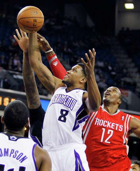 The Rockets appeared a step behind throughout Sunday's loss to the Kings, in which Sacramento's Rudy Gay (8) had 26 points. It was the latest example of what coach Kevin McHale is citing as an inconsistent effort from his team. Photo: GENEVIEVE ROSS, FRE / FR170496 AP