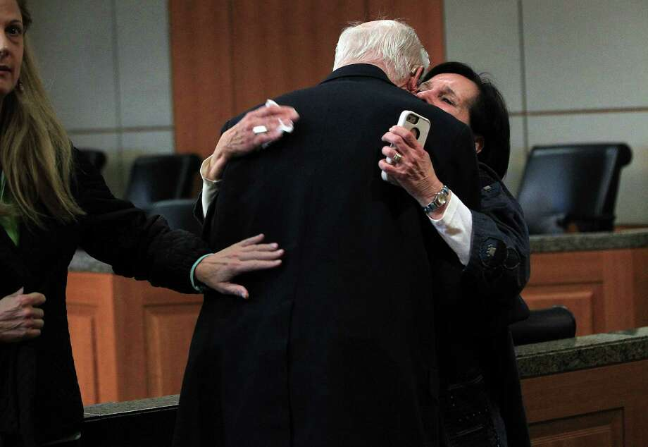 Plaintiff Earle Martin embraces plaintiff Leslie Miller after  Judge Randy Wilson read the verdict in the Ashby Highrise Trial at the Harris County Civil Courthouse on Tuesday, Dec. 17, 2013, in Houston. The jury determined project would interfere with residents property rights, and awarded some of the plaintiffs not all. ( Mayra Beltran / Houston Chronicle ) Photo: Mayra Beltran, Staff / © 2013 Houston Chronicle
