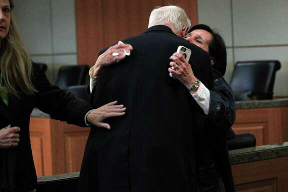 Plaintiff Earle Martin embraces plaintiff Leslie Miller after  Judge Randy Wilson read the verdict in the Ashby Highrise Trial at the Harris County Civil Courthouse on Tuesday, Dec. 17, 2013, in Houston. The jury determined project would interfere with residents property rights, and awarded some of the plaintiffs not all. ( Mayra Beltran / Houston Chronicle )