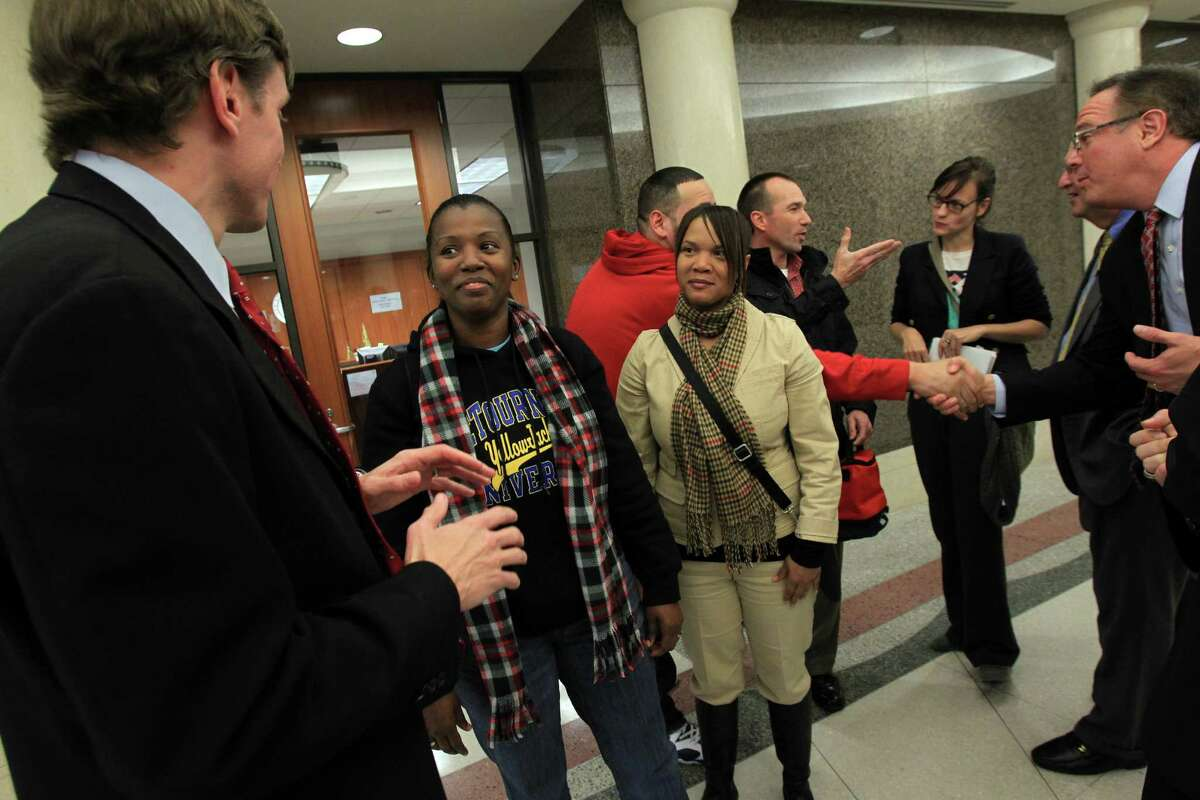 Attorneys talk to jurors Latricia Williams and Darlene Beal on Tuesday after a verdict was rendered in the Ashby high-rise dispute. The jury awarded $1.7 million in damages to 20 area residents if the project is built.