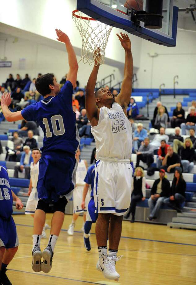 Shaker's Malik Dare goes in for a score during their high school boy's basketball game against saratoga on Tuesday Dec. 10, 2013 in Latham, N.Y. (Michael P. Farrell/Times Union) Photo: Michael P. Farrell / 00024974A