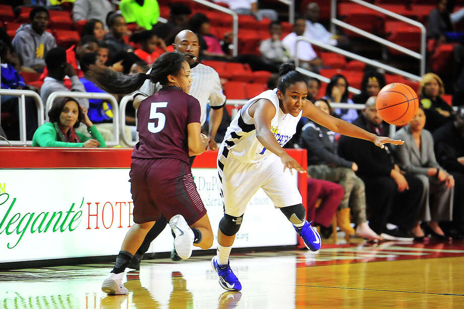 Ozen Lady Panthers Whitney Benard passes the ball past  Central Lady Jaguars Schyara Young during the third period at the Montagne Center on Tuesday. Michael Rivera/@michaelrivera88