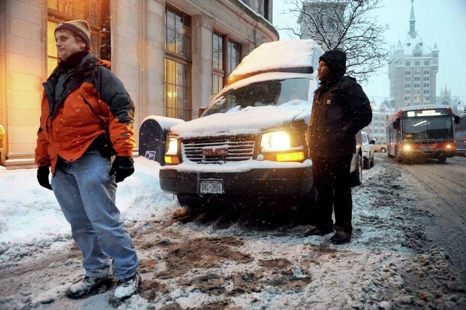 Lisanne Forgione, left, and Rolensky Alphonse, with the Homeless Action Committee outreach program, travel the streets of Albany to aide the homeless in need Tuesday evening Dec. 17, 2013 in Albany , N.Y. Cold weather makes life especially difficult for the homeless. (Michael P. Farrell/Times Union) Photo: Michael P. Farrell / 00025086A