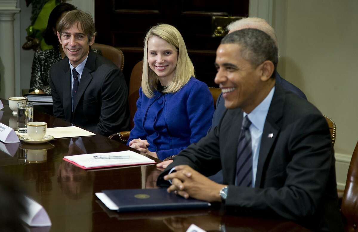 President Barack Obama meets with technology executives in the Roosevelt Room of the White House in Washington, Tuesday, Dec. 17, 2013. From left are, Mark Pincus, founder, Chief Product Officer & Chairman, Zynga; Marissa Mayer, President and CEO, Yahoo!, and Obama. (AP Photo/ Evan Vucci)
